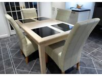 Dining Table with four leather chairs