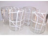 HANDMADE BLOWN GLASS TUMBLERS WITH WHITE SLIP DECORATION.