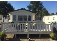 BARGAIN !!!!! 2013 Static Caravan, with large decking, sited in Essex