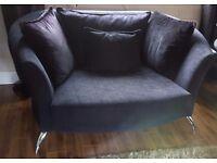 Modern black cuddler sofa