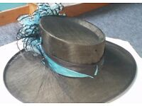 Stunning hat. As new. . Eliptical shape with stunning detail. Very comfortable to wear.