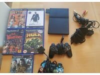 Playstation 2 with games and controller