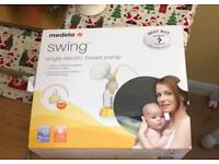 Medela swing breast pump and extra storage bottles - £50.00