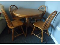 Solid wood round dining table and 4 chairs. Great condition. Sturdy set