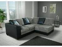 Fantastic BRAND NEW black leather and grey jumbo cord corner sofa .any side corner .can deliver