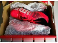 Kids' Puma football boots (studs), cerise, size 1. Boxed, hardly worn. Suit boys or girls.