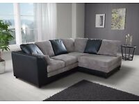 Fabulous Brand New black and grey cord corner sofa. delivery