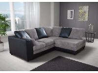 Very nice Brand New black and grey cord corner sofa. delivery