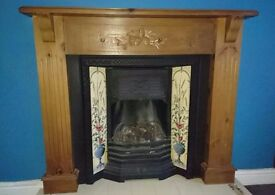 Fireplace Combination Beautiful Oak Surround with Cast Iron Insert and Decorative tiles and Gas Fire