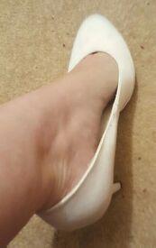 Well worn white heels size 6