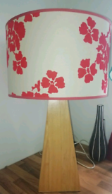 Lovely large lamp, patterned shade with wooden base.