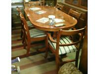 Yew wood extending dining table and 6 rulunly style chair