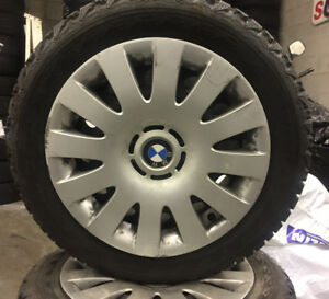 205/55/R16 winter tires on steel rims for BMW with hub caps