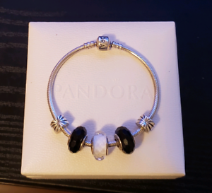 Pandora bracelet with 3 pandora charms and 2 pandora clips