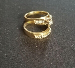 Engagement wedding rings. Gold with diamonds set in white gold