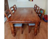 Solid wood Sturdy dining table with 6 chairs.
