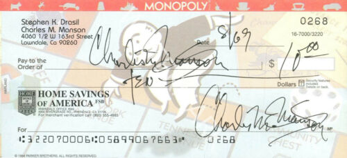 CHARLES MANSON SIGNED 10X4 MONOPOLY CHEQUE PHOTO, LOOKS AWESOME FRAMED
