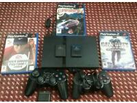 PlayStation 2 with games, controllers and memory cards