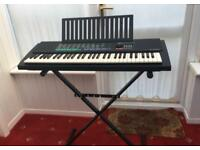 Yamaha Electric Organ PSR-150 with Stand and adaptor.
