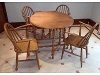 Oak gate-leg table & 2 Ercol armed chairs