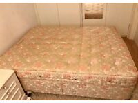 A king sized bed with mattress for sale