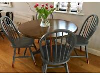 Grey round table 4 chairs copper metallic trim