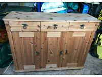Pine three-drawer, three door cupboard