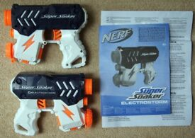 Two NERF Super Soaker Electrostorm water pistols