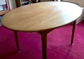 Dining room table circular solid teak 1960's vintage with hidden extending leaf Seats 8 people