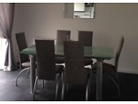 John Lewis clear frosted glass dining table with six brand new upholstered grey fabric chairs