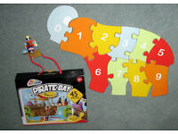2 JIGSAW ,S FOR AGE 2-3 yrs one is a wooden ELEPHANT SHAPE the other one is PIRATE BAY