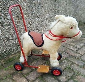 Vintage push along ride on wheeled pony