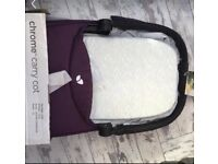 Brand new Joie chrome carrycot still in the box