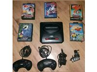 Sega mega drive 2 with 2 controllers 5 games all the leads