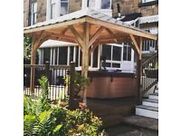 3.4m by 3.4m Larch Gazebo with free timber base and decked area