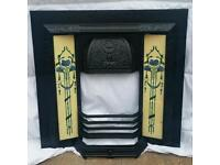 Victorian cast iron fire surround with decorative tiled sides with grate front