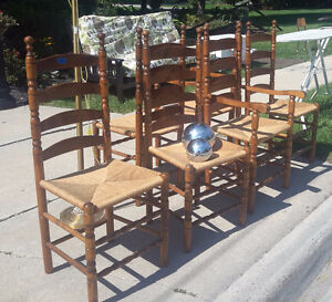 Six ladder back dining chairs with rush seats