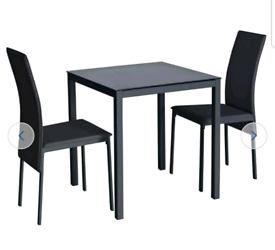 Brand new black glass dining table and 2 chairs