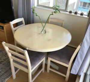 Solid wood table + 4 chairs + 2 leaf inserts, $100 (OBO)