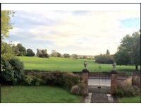 Large double room in village cottage -set in 22 acre park. Bus stop outside .