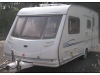 STERLING 4 BERTH LUXURY CARAVAN L SHAPE SEATING