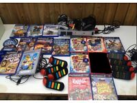 Sony Playstation 2 With 2 Controllers And 17 Games And 2 Buzz Controllers