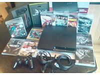 PlayStation 3 slim 320 gb with controller and 11 games