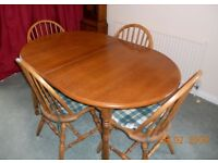Light Oak veneered din ing table with 6 chairs