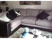 Grey fabric and leather corner sofa