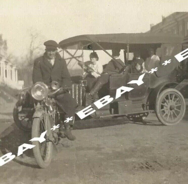 Snapshot Photo Guy Sitting On Motorcycle and Blocking Model T Ford Automobile
