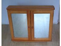 Wooden bathroom cabinet with mirror doors