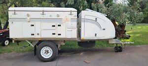 Travelander camper plus trailer