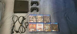 PS4 Bundle: PS4 Slim 1TB, 2 Controllers, 7 games