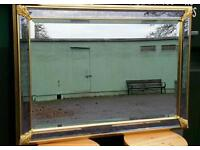 STUNNING large bevelled mirror.